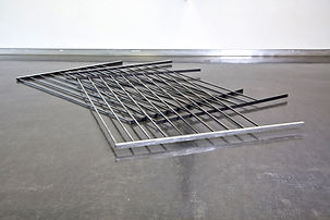 Simona Brinkmann, Bridges Become Doors - steel, graphite, burnished aluminium. Floor sculpture, contemporary art, infrastructures of control, post-minimalism.