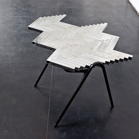 Simona Brinkmann, Sacred Symmetries, The Making at The Agency London, aluminium tube parquet floor fragment, found tubular metal chair base, sculpture, contemporary art, incline floor, interior architectural fragments.