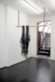Simona Brinkmann, Rig - leather, metal fittings, oak, metal chain. Hanging black leather strap sculpture, avant bridle, harness, horse tack, contemporary art, post-minimalism. Hold On! Solo show at The Agency, London.