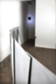 Simona Brinkmann, detail of exhibition view, Blank Stare Flat Hollow, solo show at Five Years, London. Strobe spot light corner installation, barrier floor sculpture, feather sculpture.