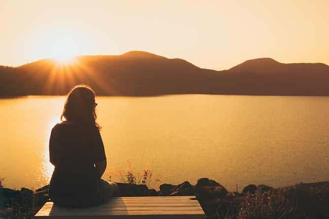 The silhouette of woman sitting alone, c