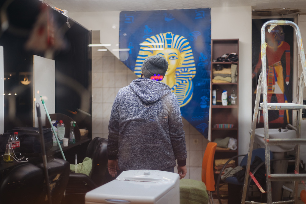 Photo of man looking at Egyptian pharaoh decor in his new shop in Budapest