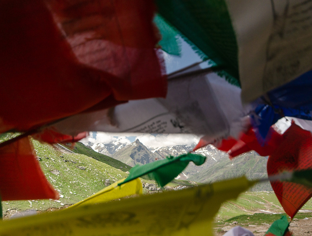 Shot of Indian himalayas through prayer flags in North India
