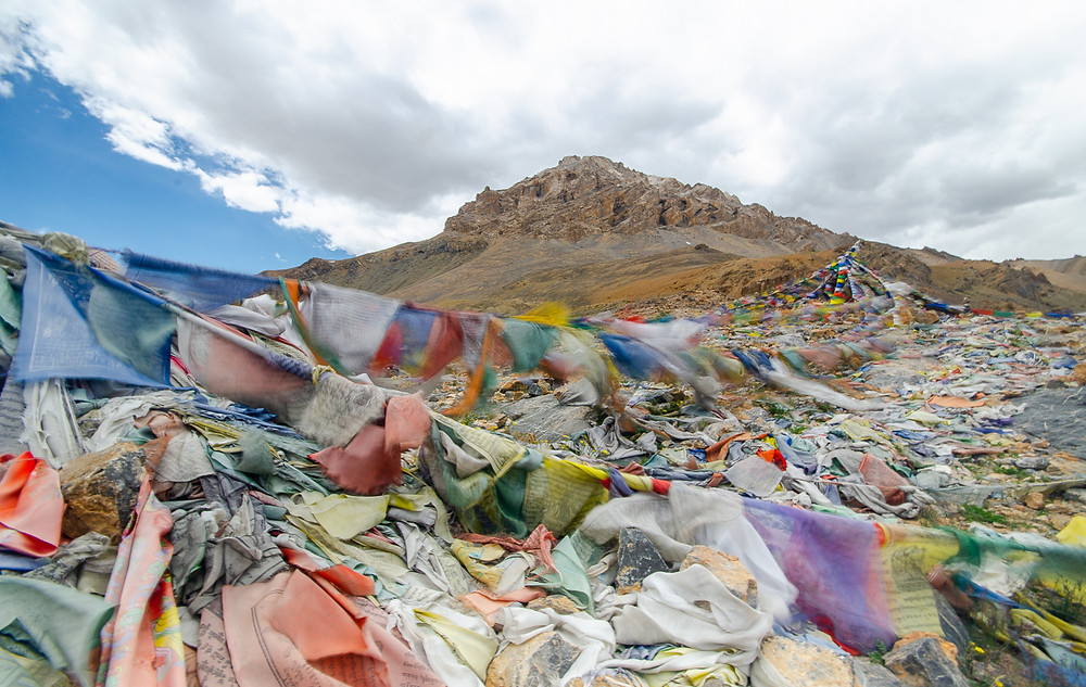 Long exposure shot of prayer flags in wind on bus journey through Indian Himalayas