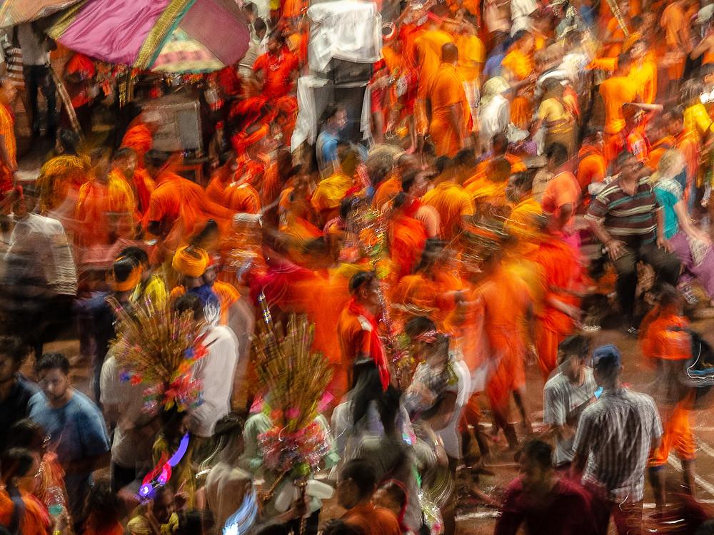 hindu crowds dressed in orange swarming in long exposure shot in varanasi india