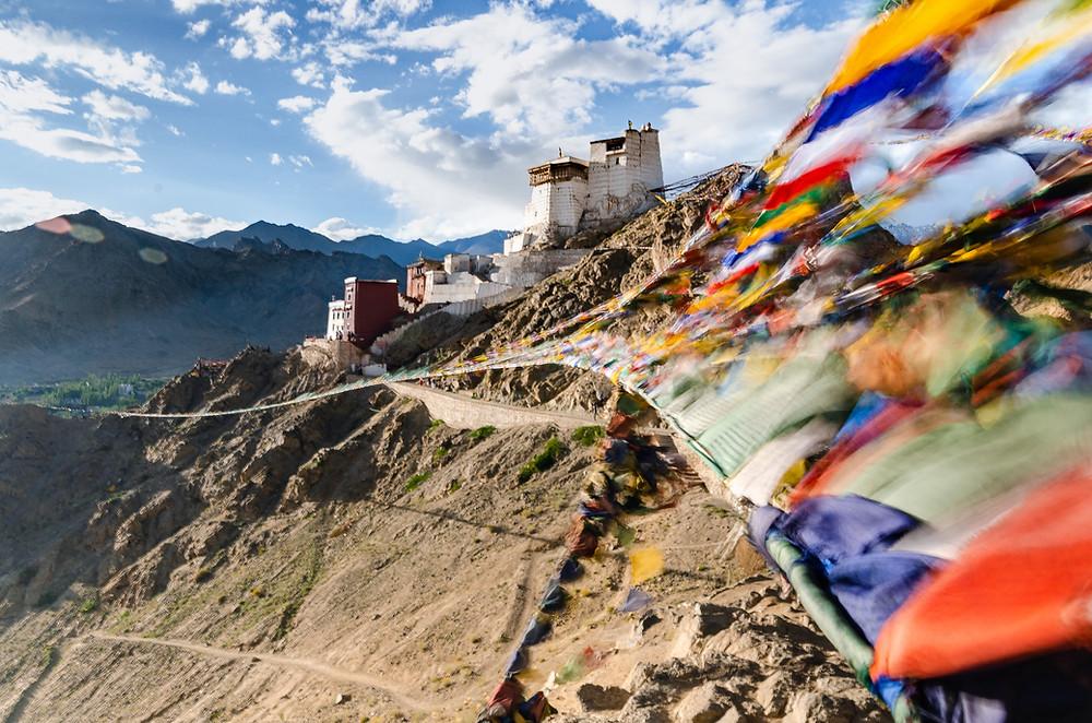 Long exposure photography of tibetan prayer flags over Namgyal Tsemo Gompa in leh ladakh