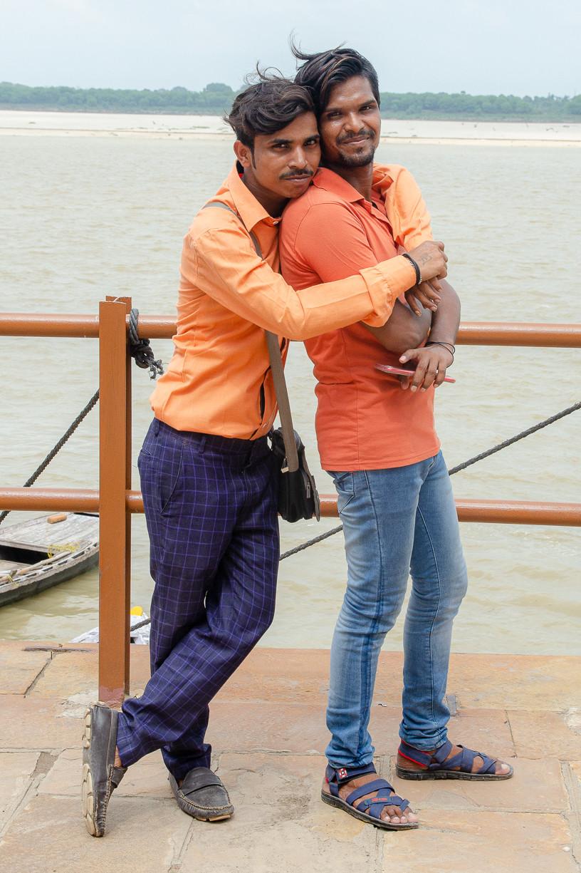 two male indian men hugging in varanasi india