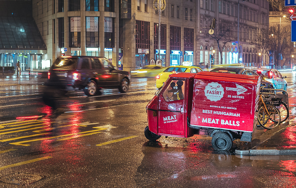 Long exposure shot of Hungarian meat ball van on road in Budapest