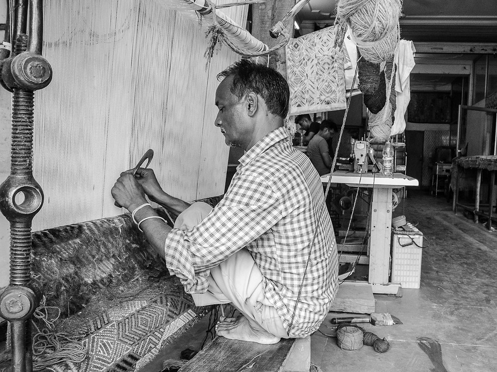 man working in textile factory in jaipur india