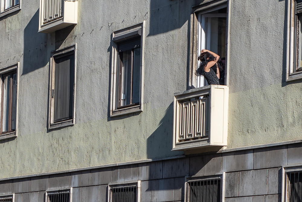 Woman posing for photographs on flat balcony in Budapest