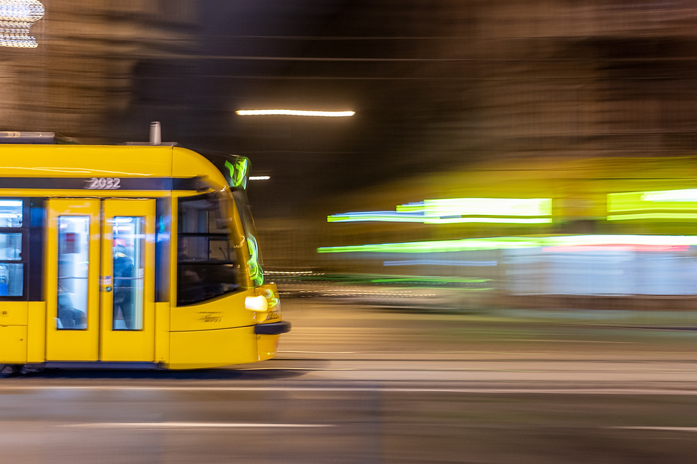 Long exposure blur shot of yellow tram in Budapest