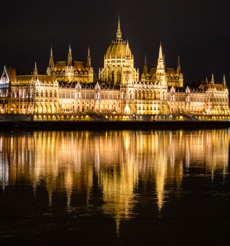 The Hungarian house of parliament in Budapest, at night and reflected in Danube river