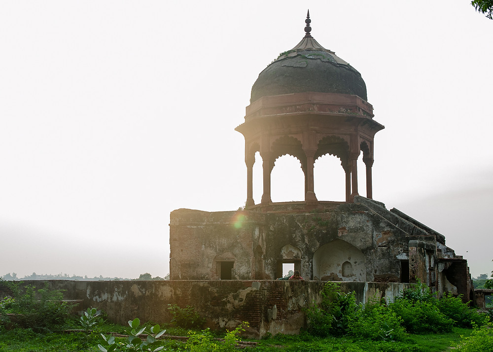 ancient crumbling spire sunset in agra india