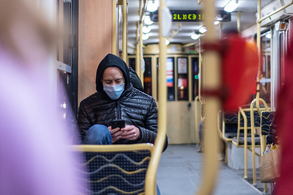 Man in COVID-19 face mask on tram during January 2021 in Budapest