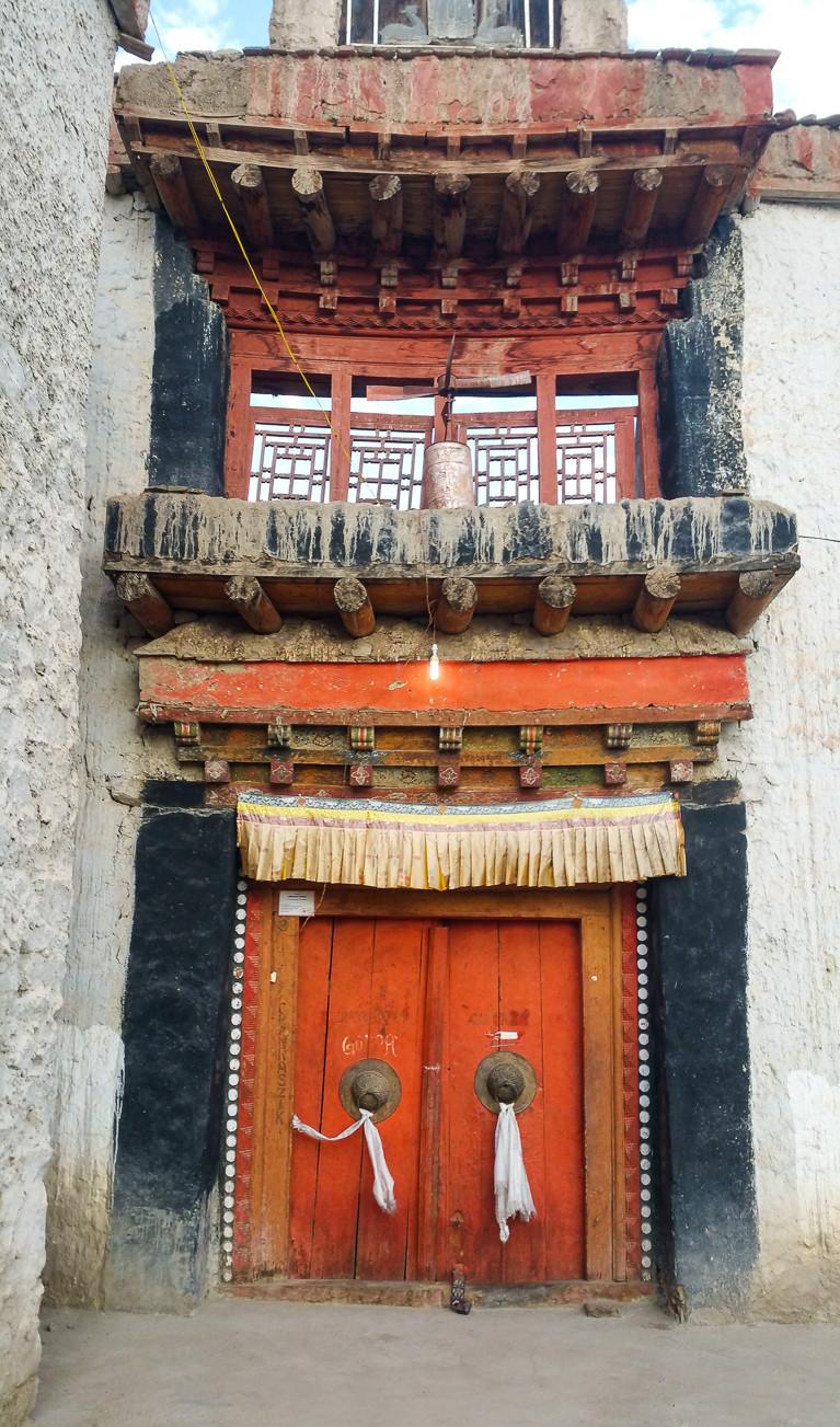 Ancient red door to buddhist temple in Leh, Ladakh, India