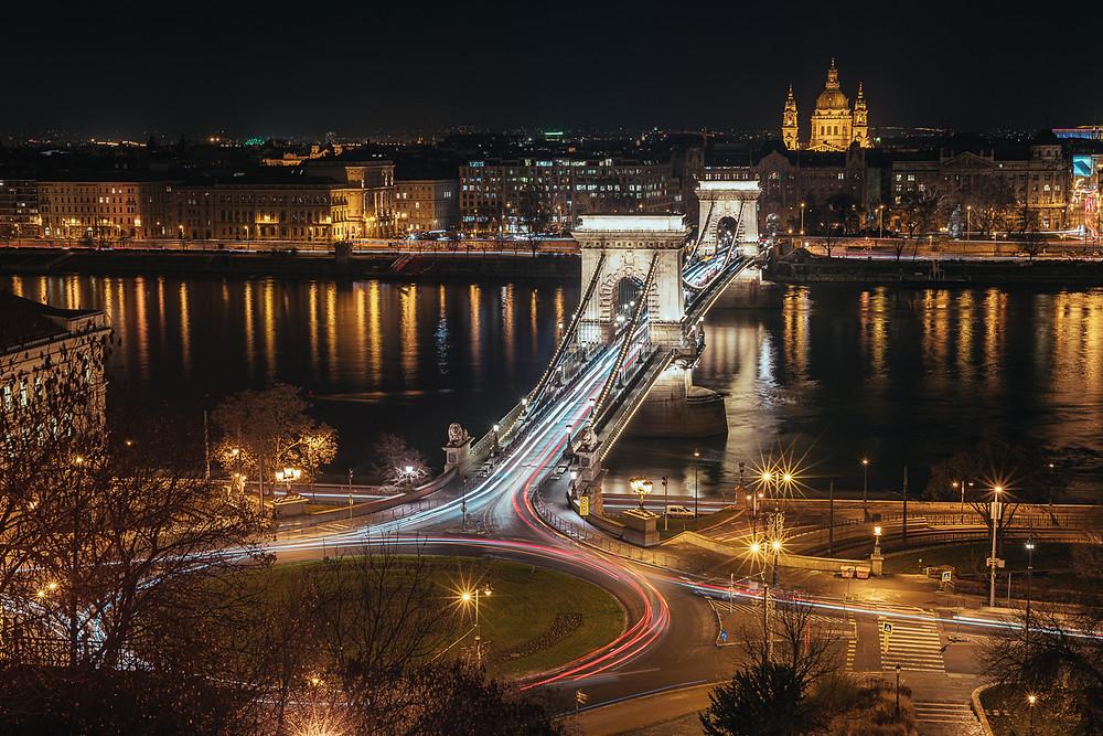 Long exposure shot of traffic across the chain bridge in Budapest