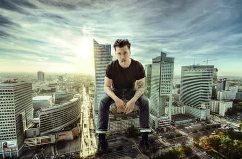 Guy sitting on building