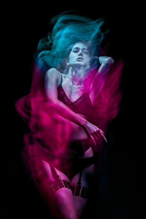 Creative light streaks image of model Nymphilia