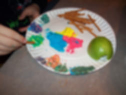 Colorful snack plate, mixing colors in dip