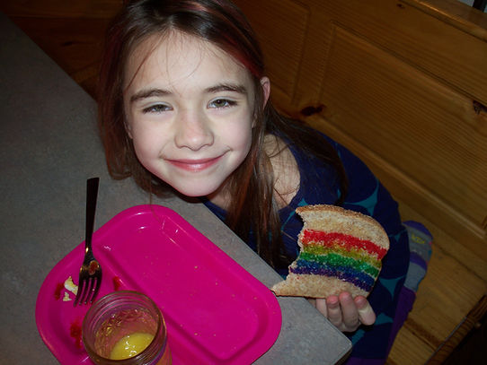 Child eating special breakfast, rainbow toast