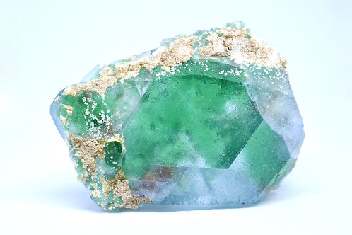 Green Transparent Fluorite with Muscovite