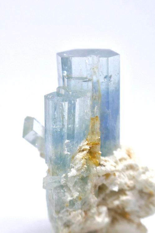 Beryl var. Aquamarine Cluster on Feldspar