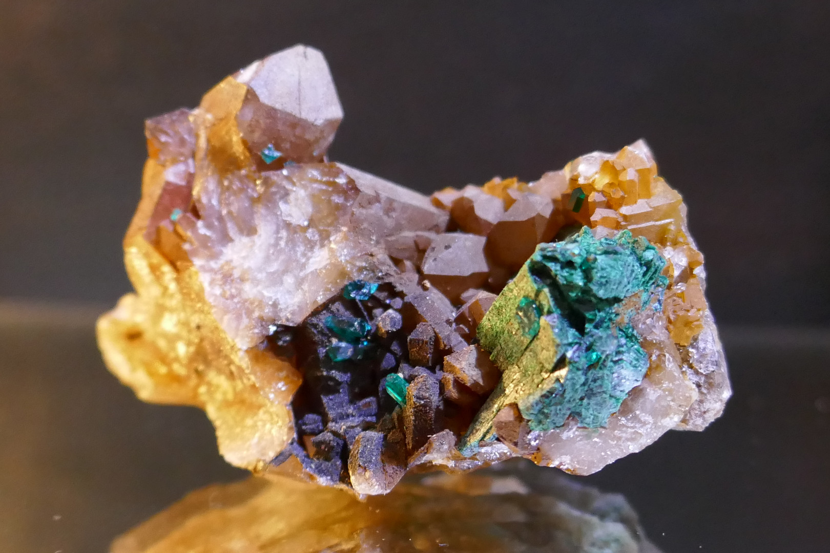 Goethite stained Quartz with Dioptase and Malachite