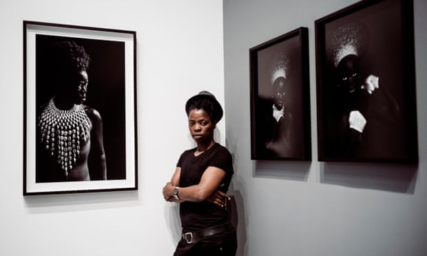 Muholi at her new exhibition. Photograph: Sarah Lee/The Guardian