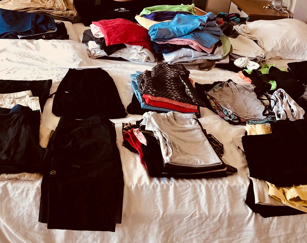 Packing exercise, clothes out on bed