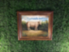 Painting of cow in a field, centered on artificial boxwood custom wall accent headboard in eclectic corporate condo remodel | Wilk Design Workshop
