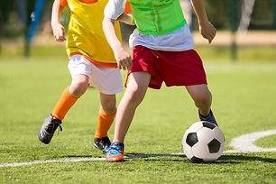 Close-up of kids playing soccer.jpg