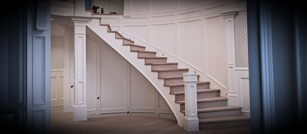 Image of newly installed stairs with square stair nosings in a brown colour with white walls