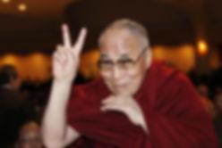 dalai-lama-directs-peace-sign-towards-ba