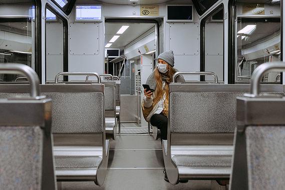 woman-wearing-mask-on-train-3962264.jpg