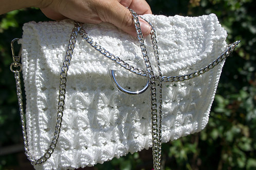White clutch bag with silver chain
