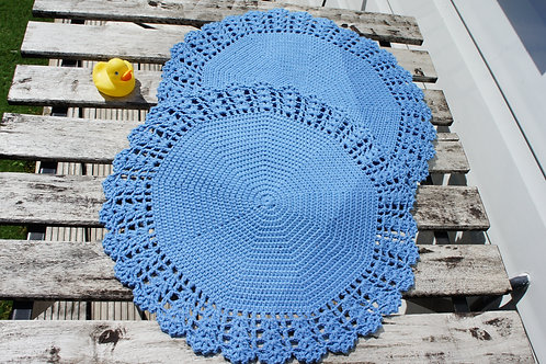A Set of Two Round Crochet Placemats (blue)
