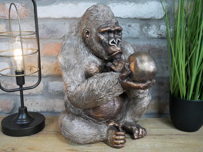 Gorilla Holding a Skull