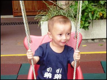 Dian gets the joy of swings