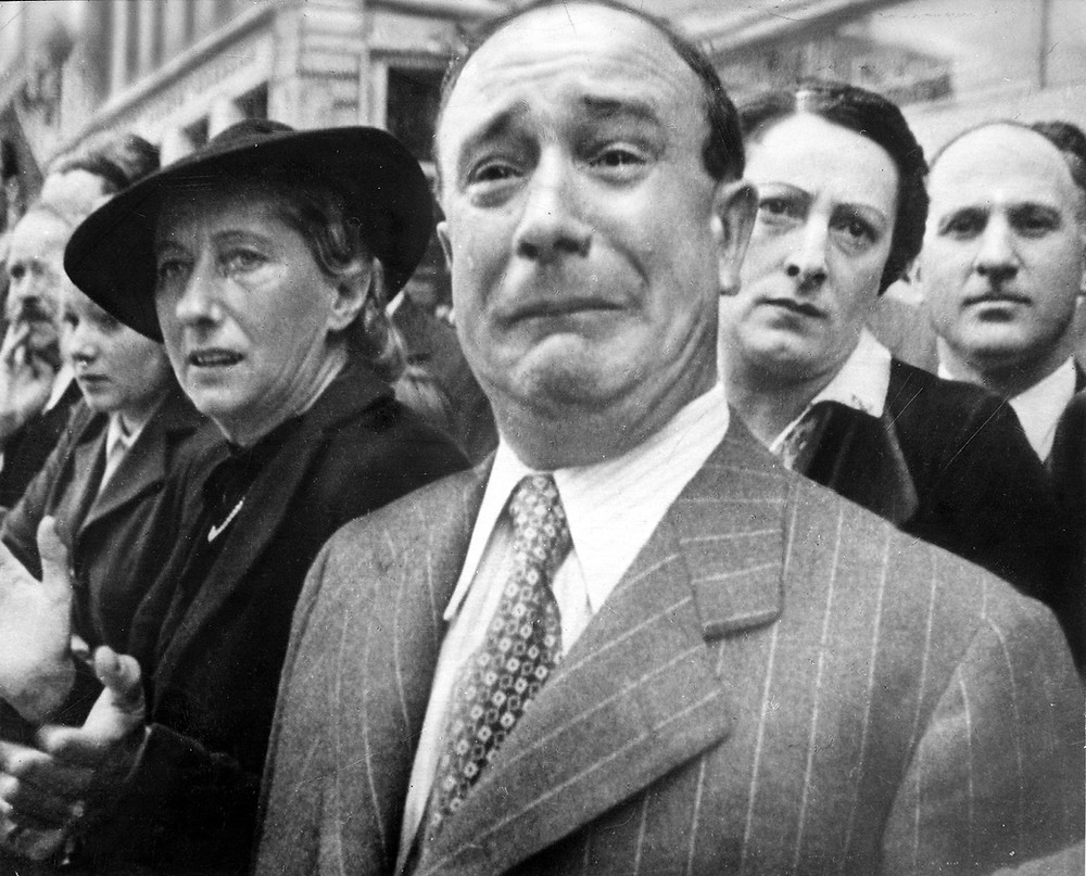 """""""A Frenchman sheds tears of patriotic grief as flags of his country's lost regiments are exiled to Africa"""", according to the caption in the 3 March 1941 issue of Life magazine. Incorrectly captioned by NARA as """"A Frenchman weeps as German soldiers march into the French capital, Paris, on June 14, 1940, after the Allied armies had been driven back across France."""""""