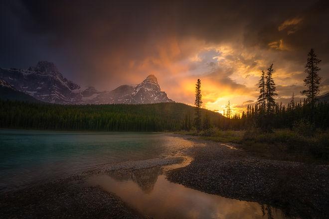 Beautiful mountains and bight blue lake during sunset