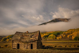 Crested Butte Fall Color Colorado with old barn and fog