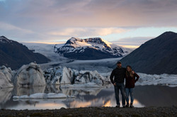 dan ballard and nicole albrecht stand in front of glacier