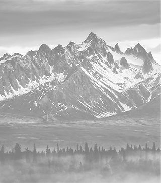 Jagged mountains with snow faded in background