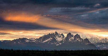 Alaska Mountain Range faded in background