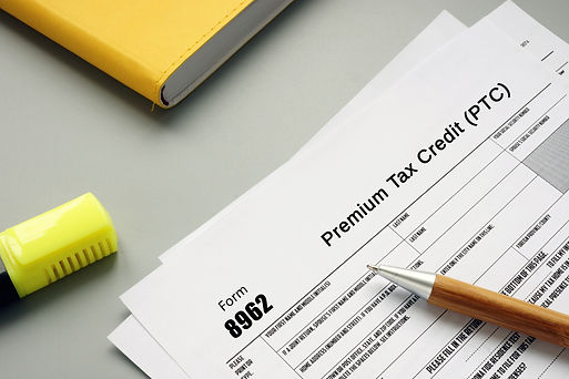 Image of individual filling out a form for Premium Tax Credits.