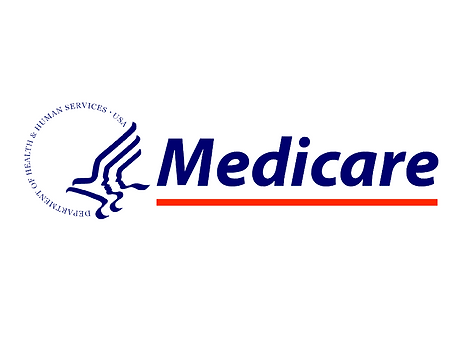 Image of an indvidual holding a Medicare insurance card.