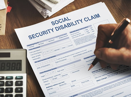 Image of an indivudal filling out an application form for Social Security Disability Insurance.