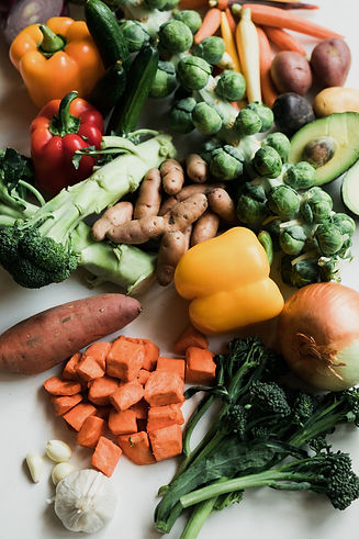 Image of assorted vegetables, including bell peppers, carrots, onions, avocado, and potatoes