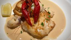 Grouper cheeks lobster crostinis bisque sauce
