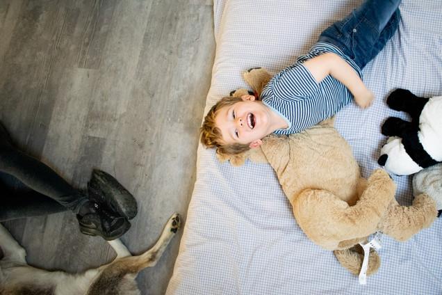 Arto giggling on bed.jpg